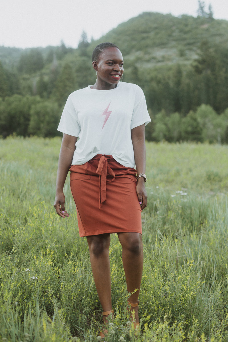 Piper & Scoot: The Mimi Cinch Casual Skirt in Brick, lifestyle shoot; front view