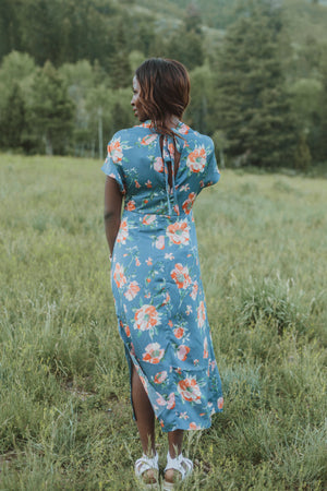The Jonah Silk Floral Dress in Blue, lifestyle shoot; back view