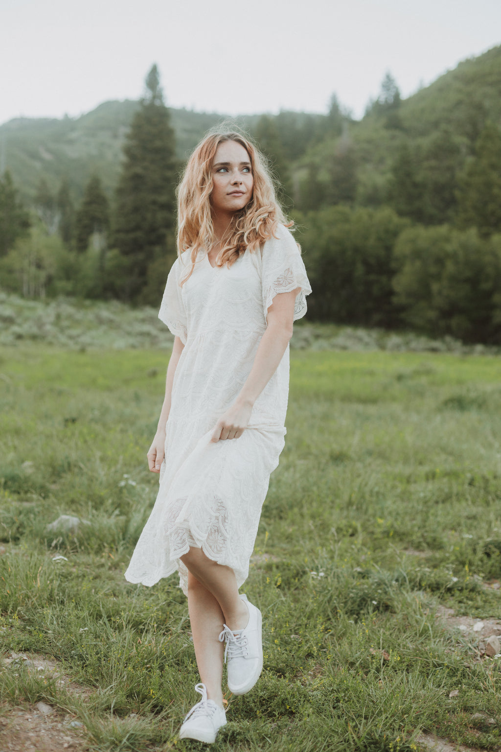 The Finn Delicate Lace Dress in Ivory, lifestyle shoot; front view
