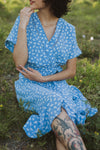 The Beckham Floral Wrap Dress in Periwinkle, lifestyle shoot; front view