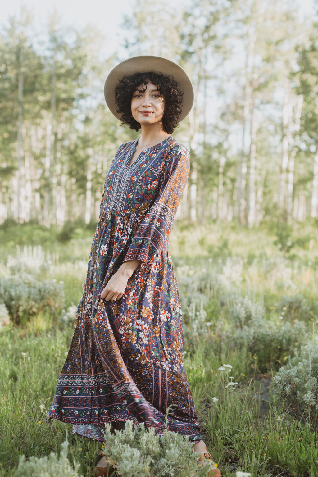 ,The Brockton Patterned Maxi Dress in Navy, lifestyle shoot; front view