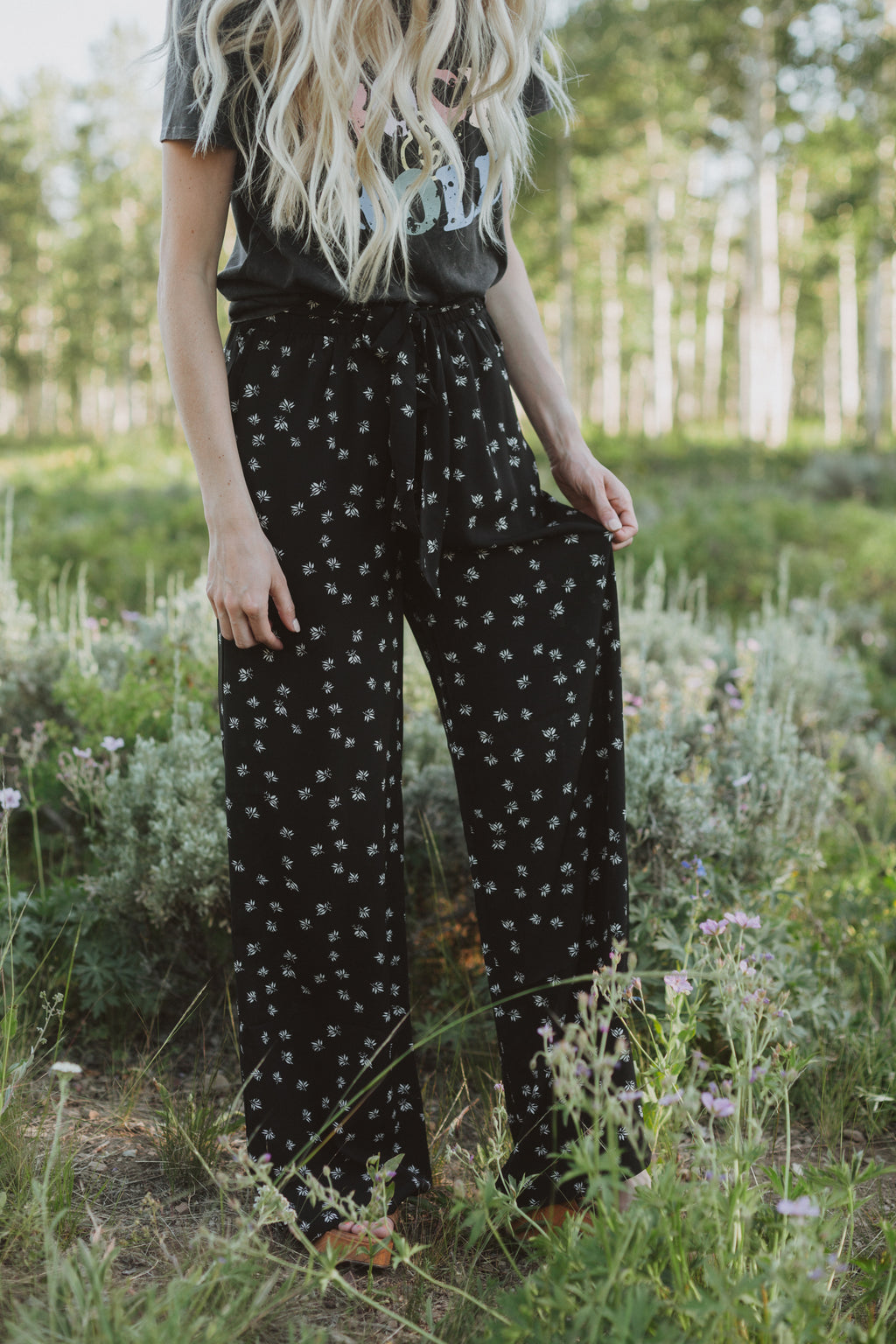 The Corbin Printed Wide Leg Trouser in Black, lifestyle shoot; front view