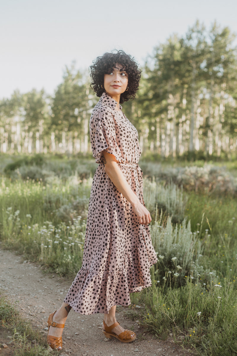 The Brooks Wrap Front Patterned Dress in Mauve, lifestyle shoot; side view