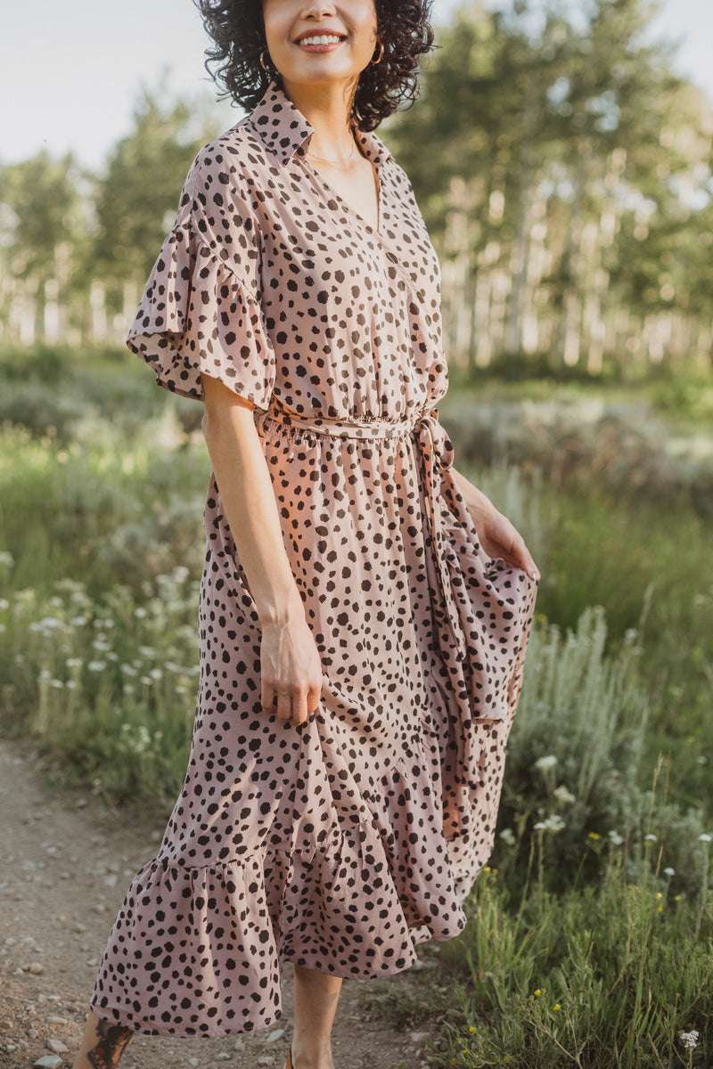 The Brooks Wrap Front Patterned Dress in Mauve, lifestyle shoot; front view