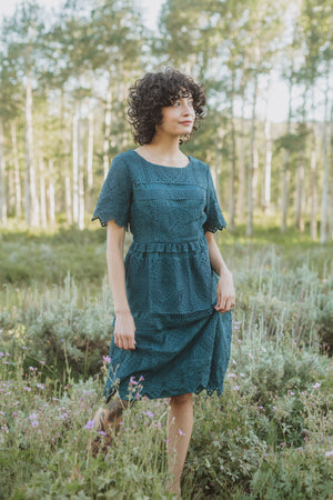 The Chenoa Lace Detail Dress in Jade, lifestyle shoot; front view