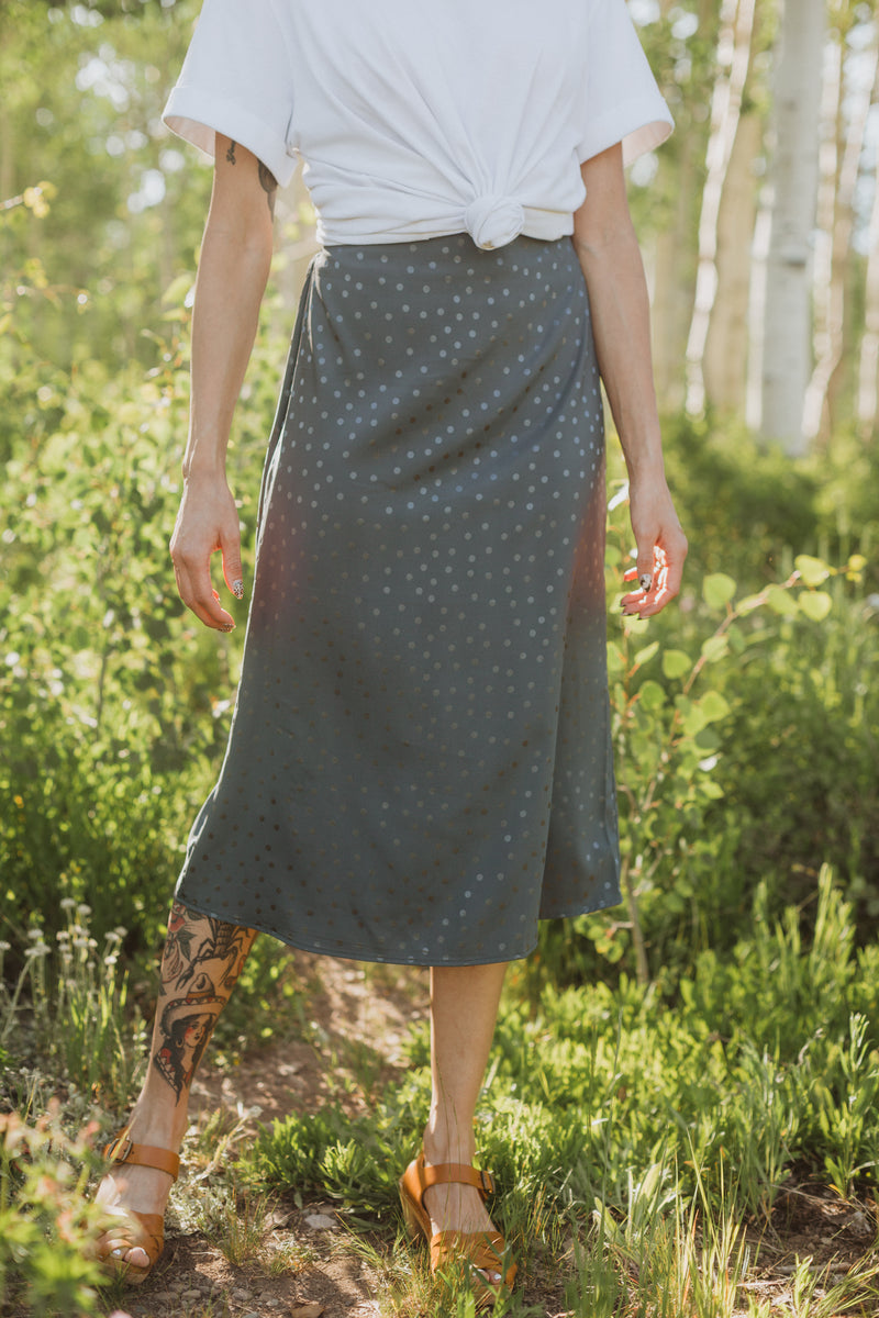 The Rylan Dot Silk Skirt in Blue, lifestyle shoot; front view