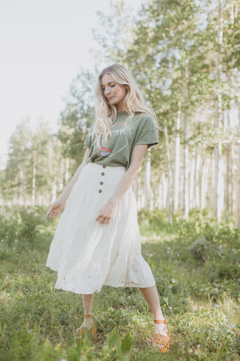The Ronan Tiered Button Skirt in Cream, lifestyle shoot; front view