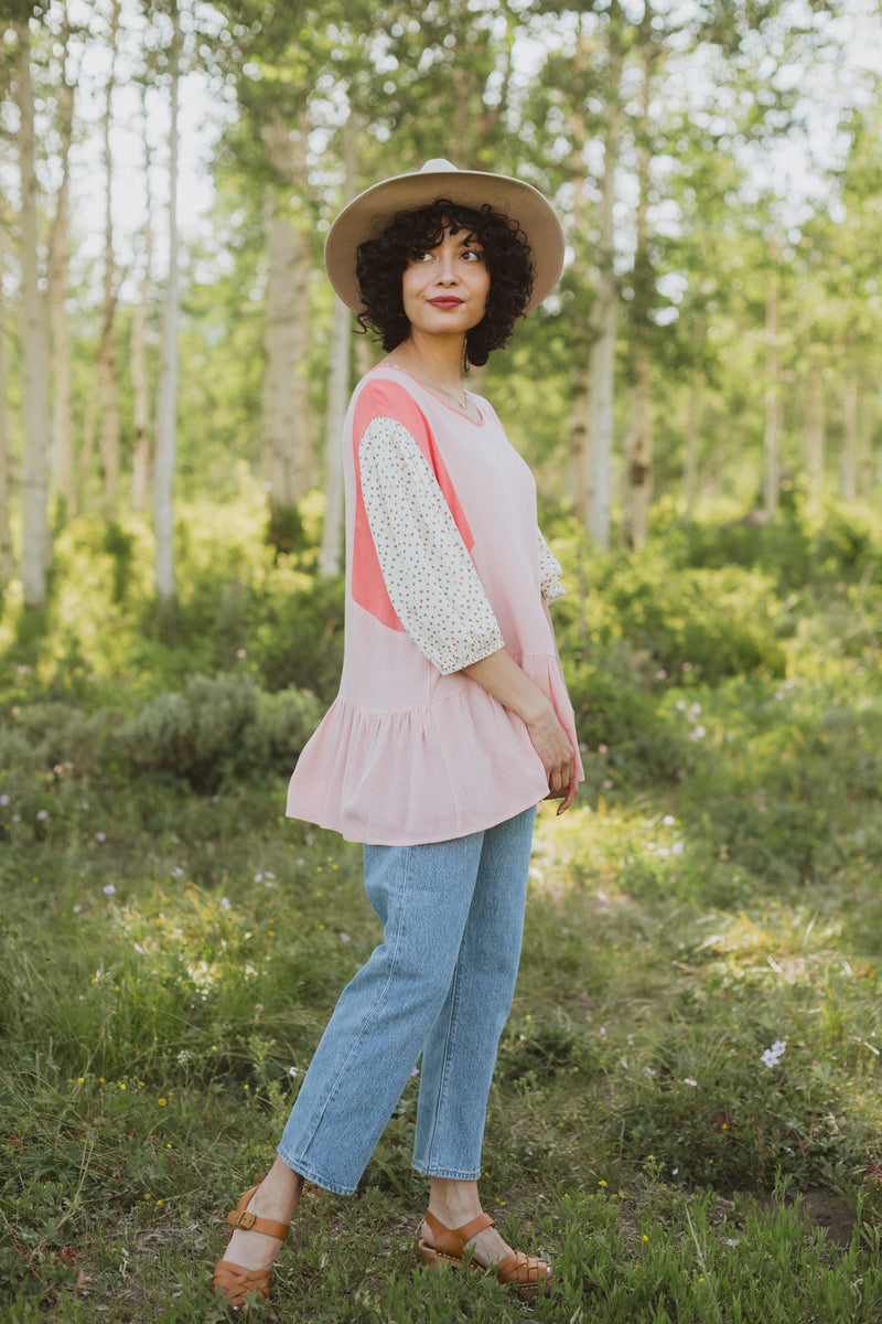 The Miranda Patterned Peplum in Rose, lifestyle shoot; front view