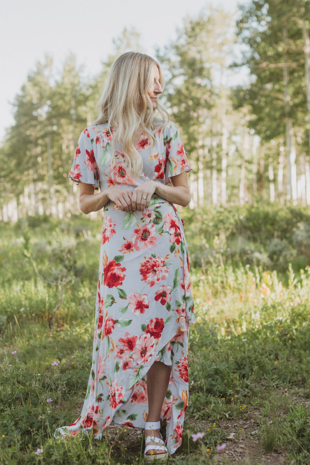 , The Kameron Floral Wrap Dress in Dusty Periwinkle, lifestyle shoot; front view