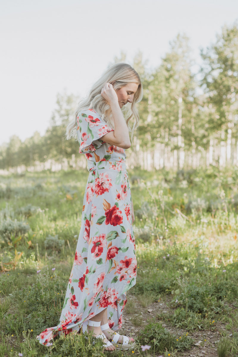 , The Kameron Floral Wrap Dress in Dusty Periwinkle, lifestyle shoot; side view