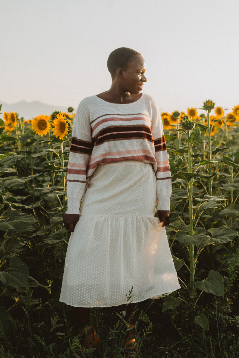 The Lynden Striped Knit in Cream, lifestyle shoot; front view