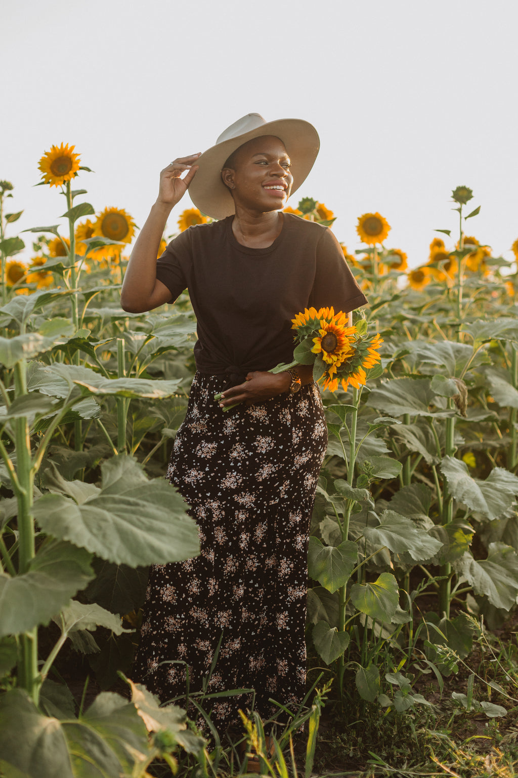 The Wolov Speckled Maxi Skirt in Black, lifestyle shoot; front view