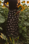 vThe Wolov Speckled Maxi Skirt in Black, lifestyle shoot; front view