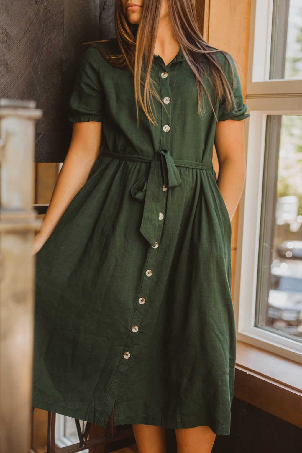 The Efron Button Front Dress in Emerald, lifestyle shoot; front view