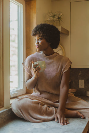 The Ariana Pleated Set in Blush, lifestyle shoot; front view
