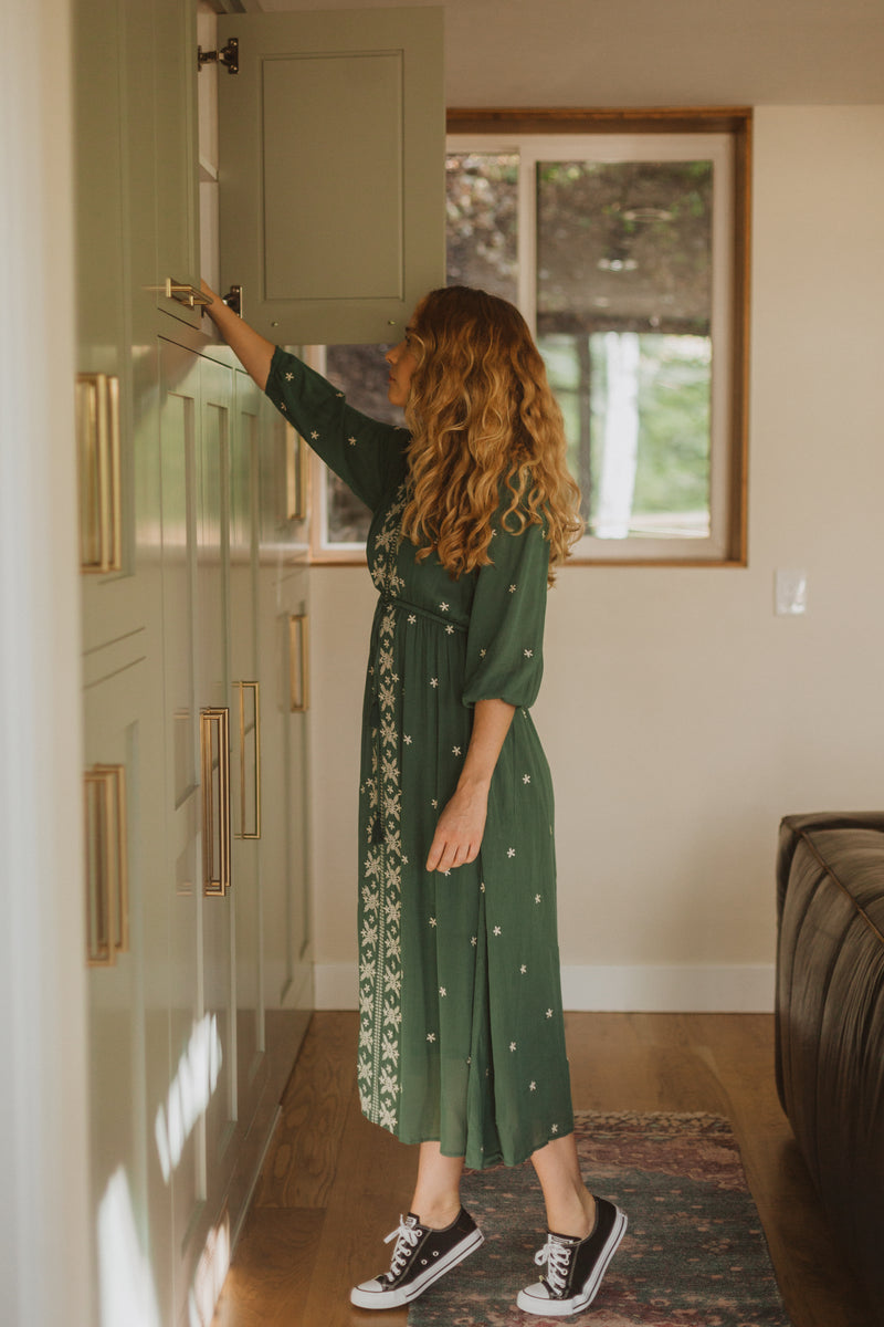 Piper & Scoot: The Alida Dress in Hunter Green, lifestyle shoot; side view