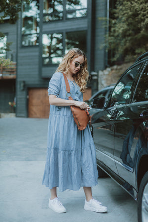 The Bruns Tiered Maxi Dress in Dusty Blue, lifestyle shoot; side view