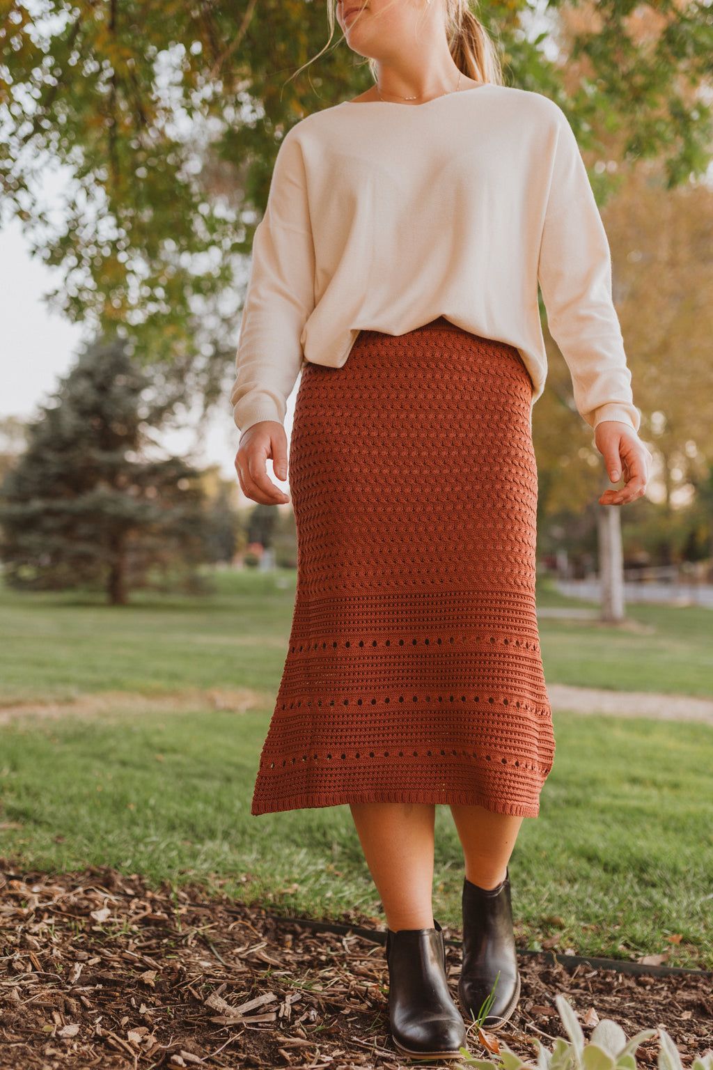 The Tom Knit Skirt in Brick, lifestyle shoot; front view
