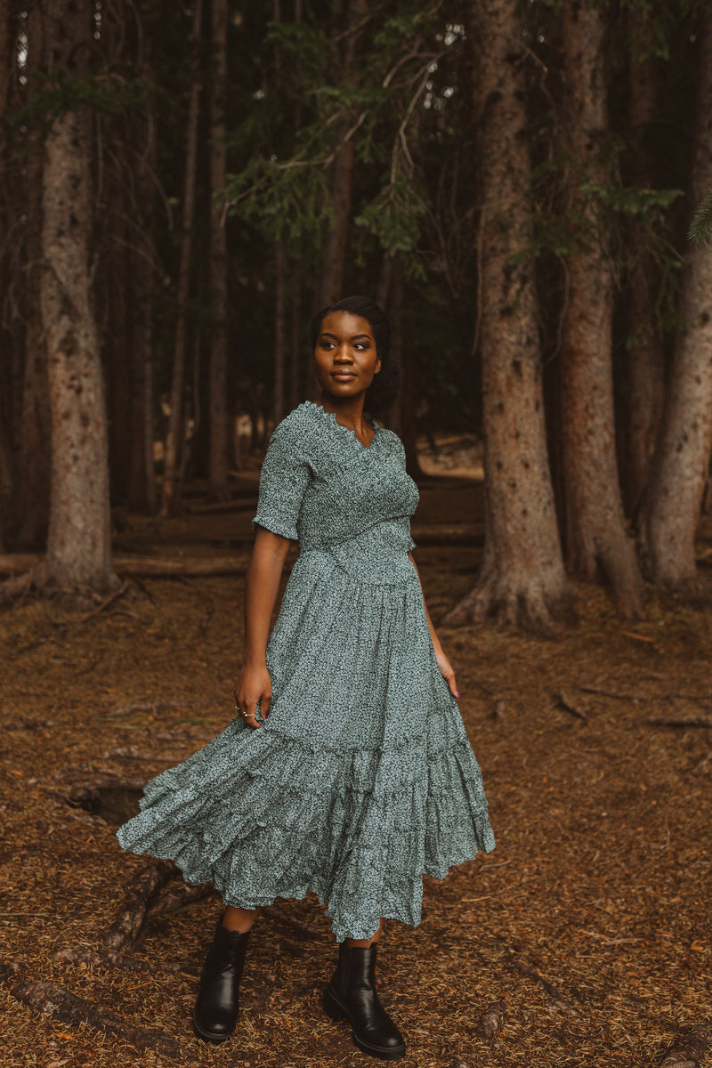 The Mumulo Pattern Smocked Tiered Dress in Blue, lifestyle shoot; front view