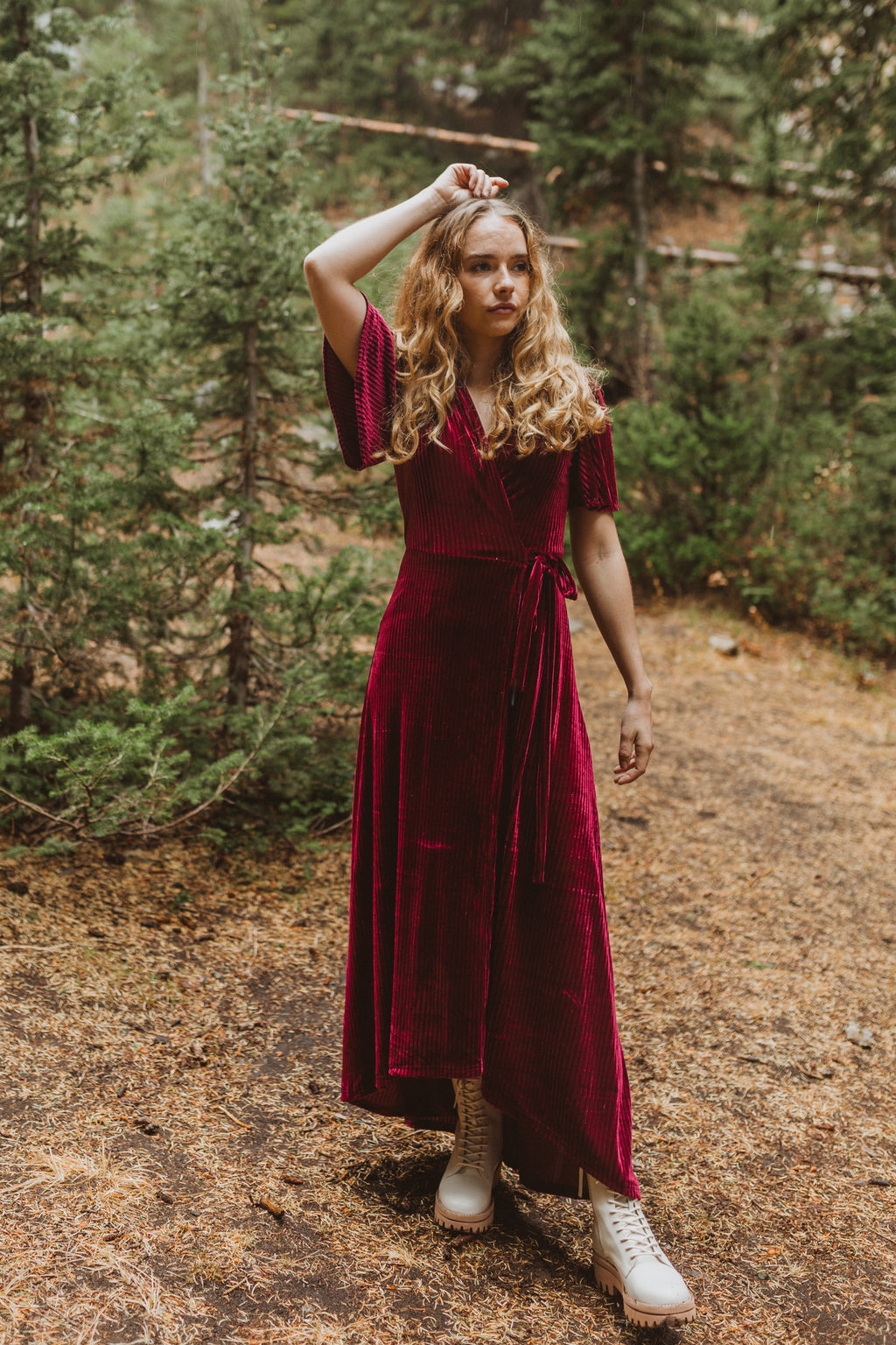 The Banton Pleated Velvet Maxi Dress in Burgundy, lifestyle shoot; front view
