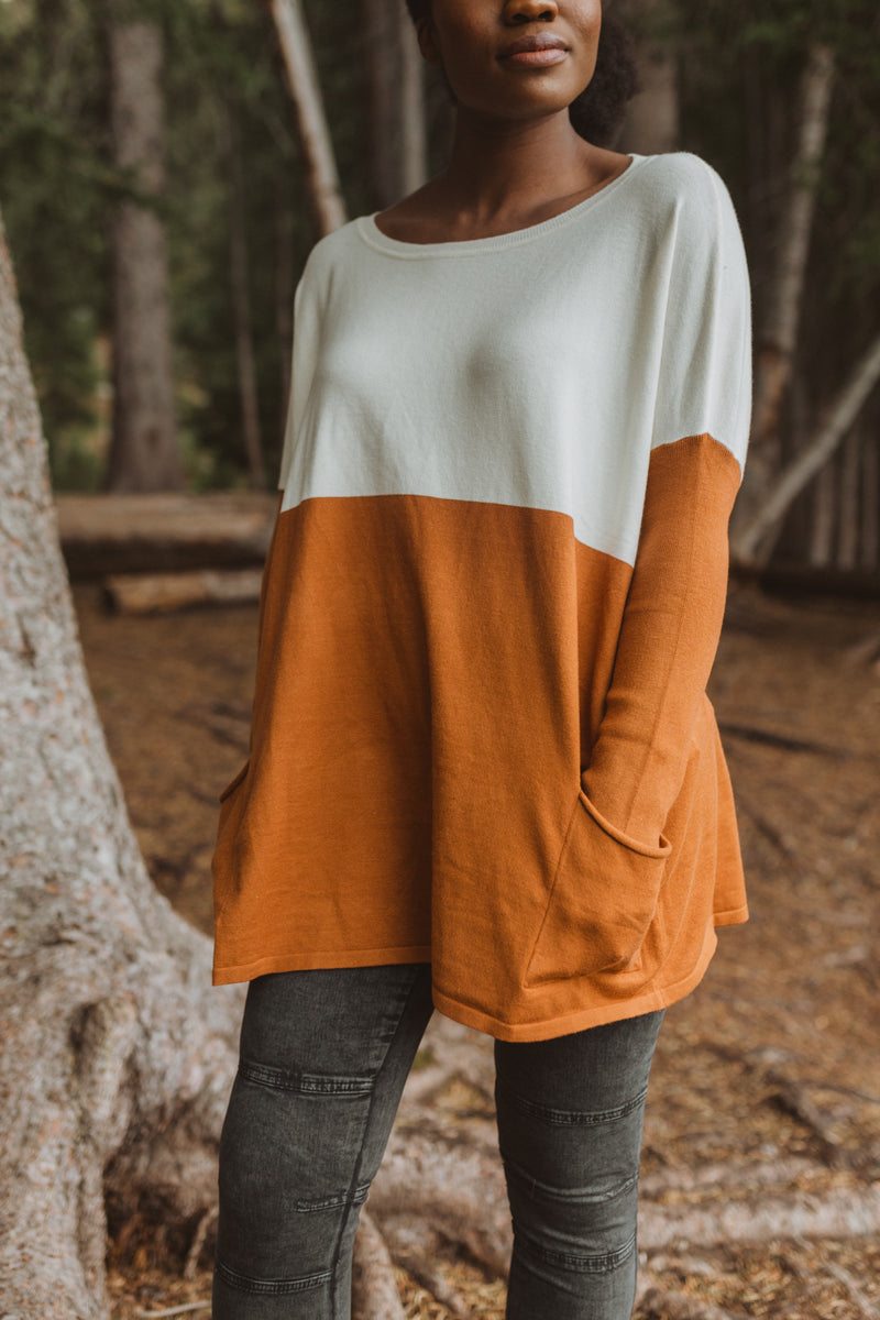 The Strike Casual Pocket Sweater in Camel + Ivory, lifestyle shoot; front view