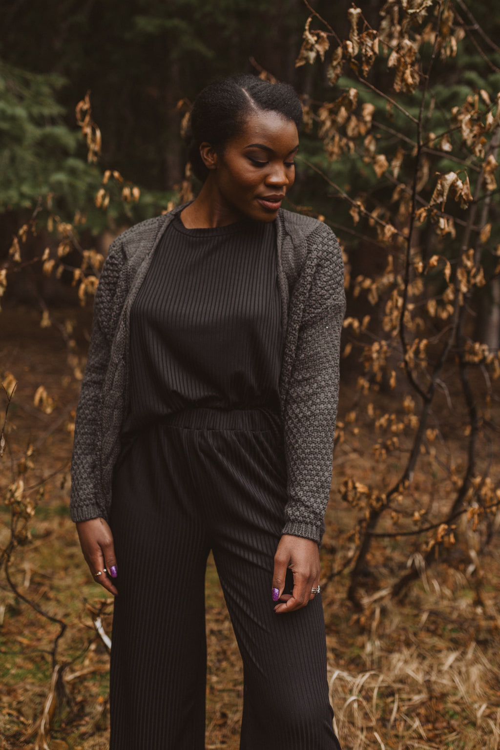 The Radcliffe Crochet Cardigan in Charcoal, lifestyle shoot; front view