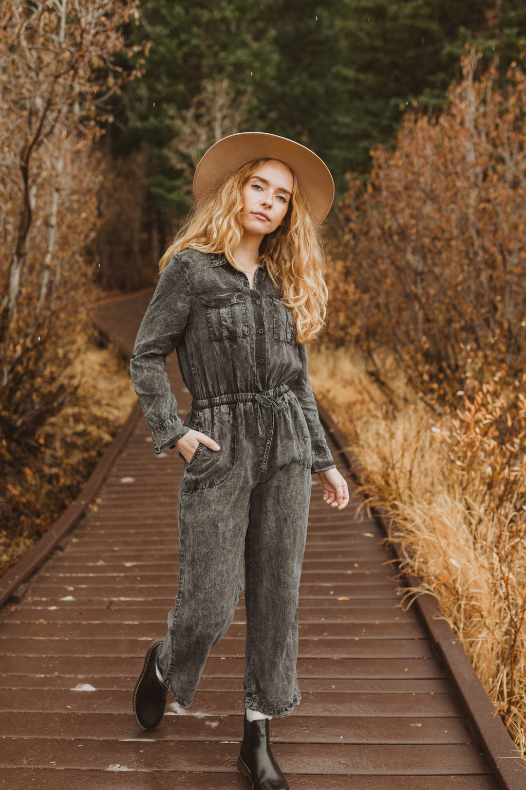 The Ling Casual Jumpsuit in Faded Black, lifestyle shoot; front view