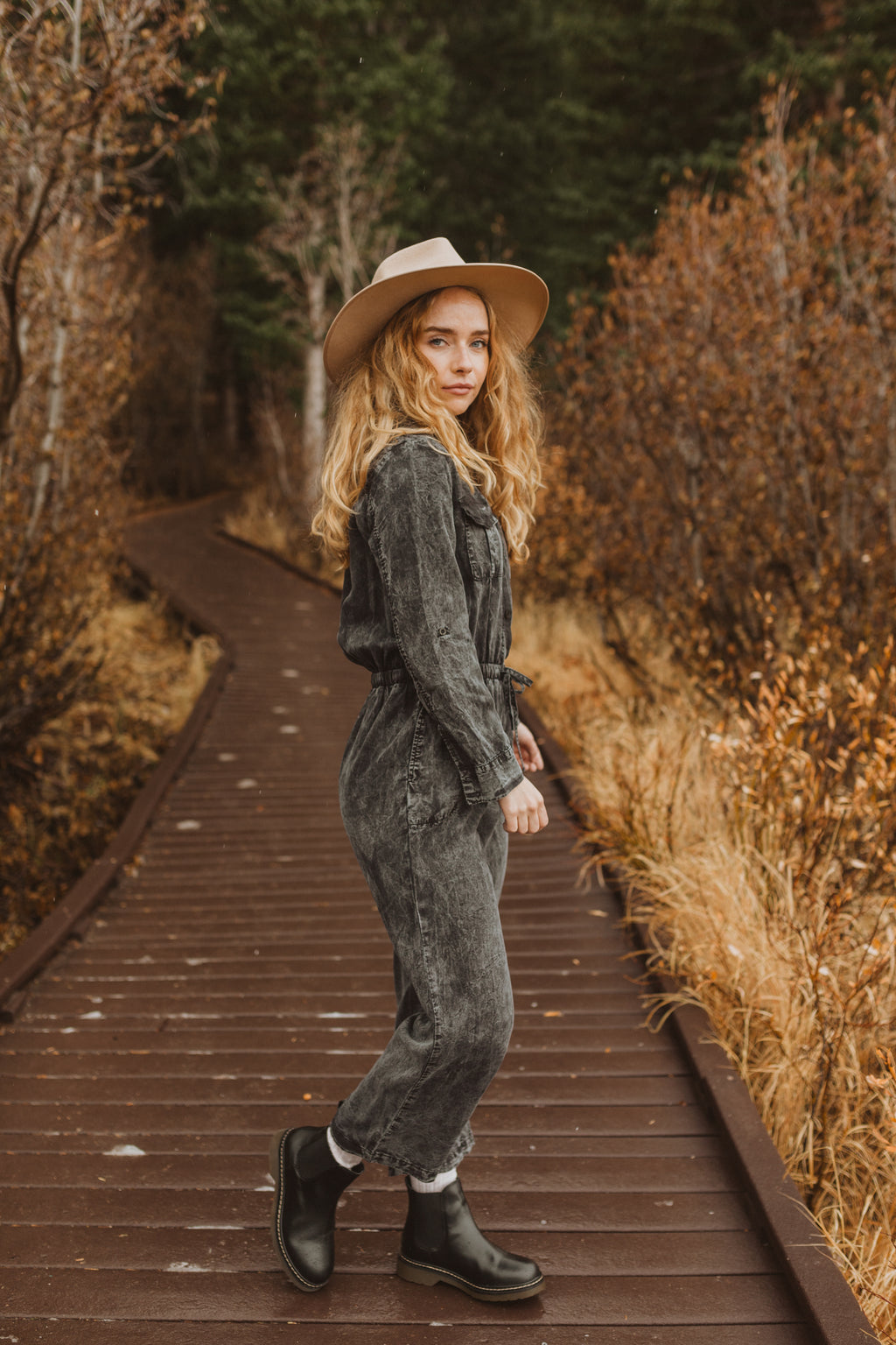 The Ling Casual Jumpsuit in Faded Black, lifestyle shoot; side view