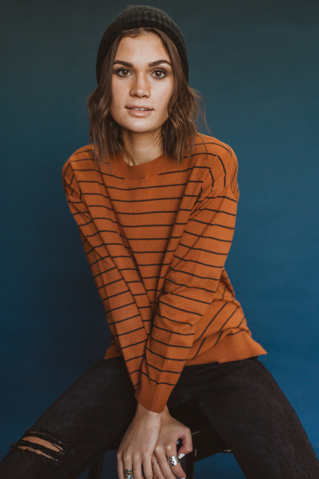 The Viggo Striped Knit in Brick, studio shoot; front view