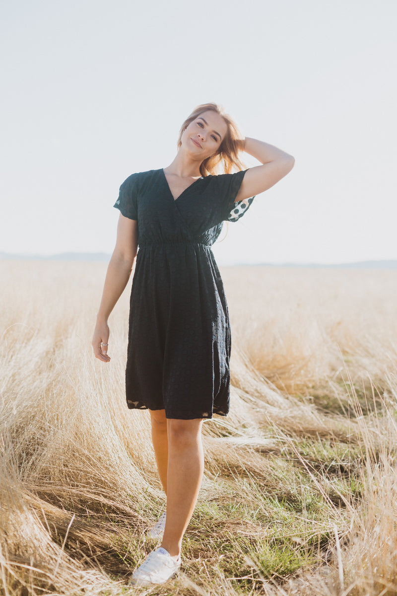 Piper & Scoot: The Evie Dot Wrap Dress in Navy, lifestyle shoot; front view