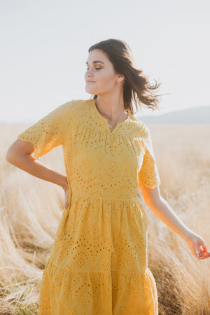 Piper & Scoot: The Brecken Eyelet Tiered Dress in Mustard, lifestyle shoot; front view