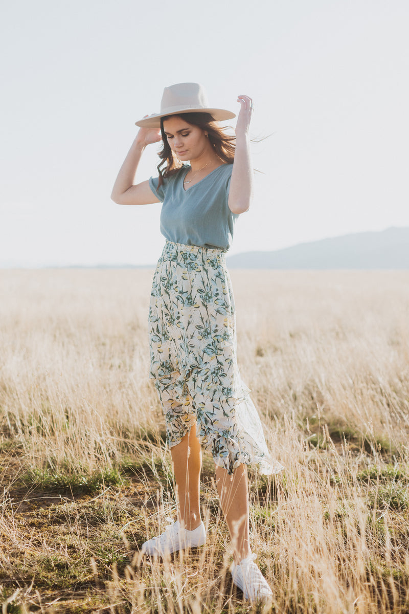 The Louisa Floral Ruffle Skirt in Natural, lifestyle shoot; side view