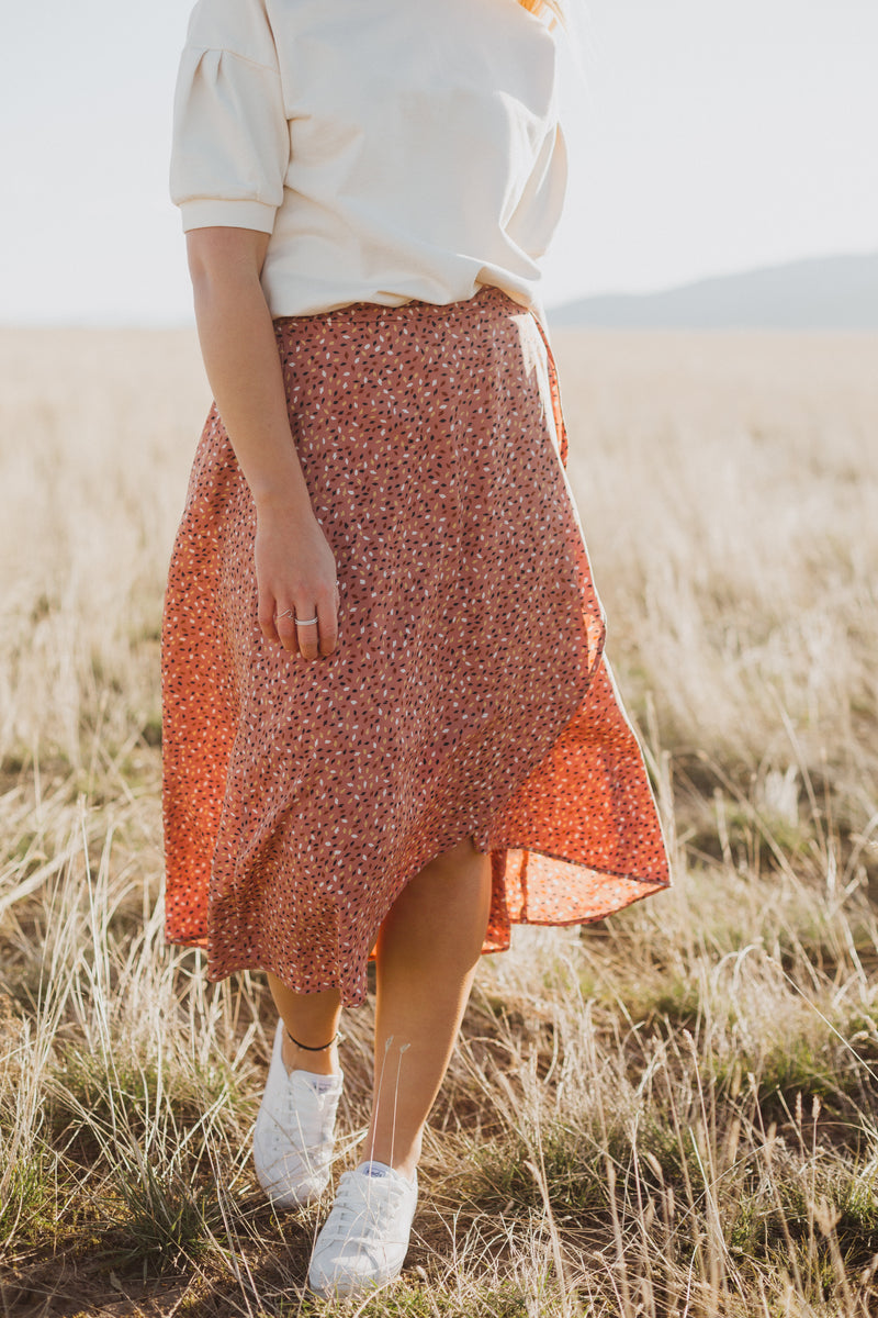 The Guiliana Patterned Wrap Skirt in Mauve, lifestyle shoot; front view