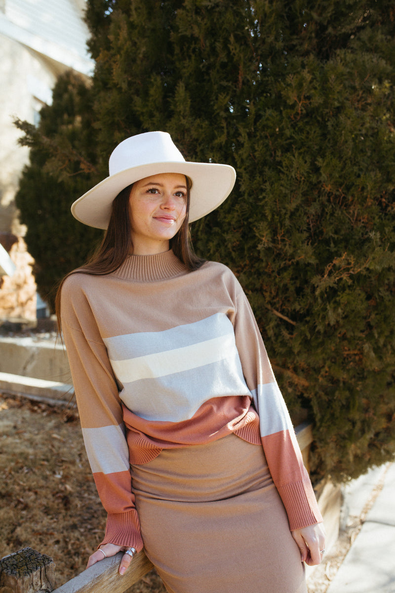 The Bob Striped Mock Neck Sweater in Taupe, lifestyle shoot; front view