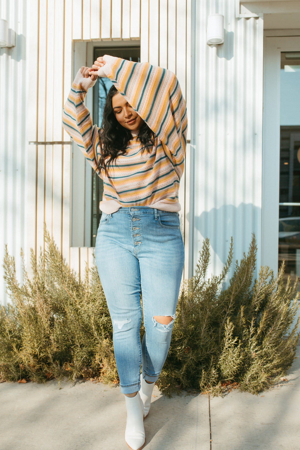 The Loren Striped Sweater in Mustard, lifestyle shoot; front view