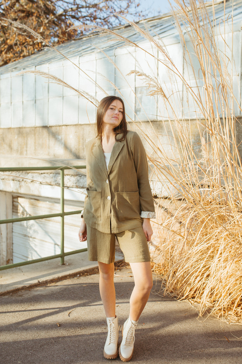 The Berry High Rise Short in Olive, lifestyle shoot; front view