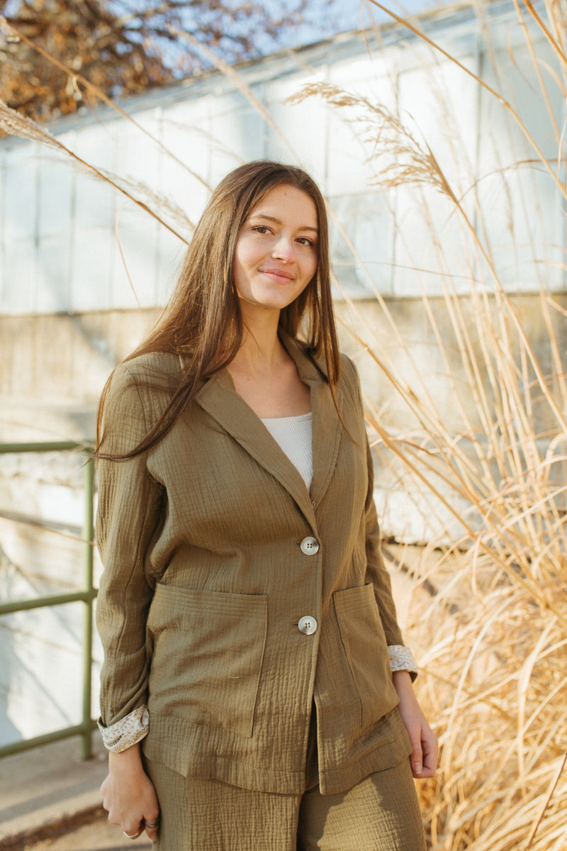 The Halle Relaxed Button Up Blazer in Olive, lifestyle shoot; front view