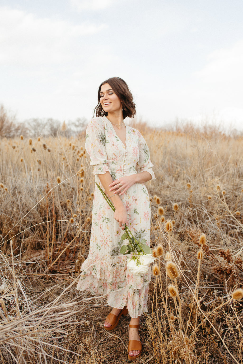 The Mystique Floral Maxi Dress in Off White, lifestyle shoot; front view