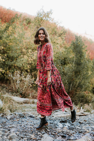 The Brockton Patterned Maxi Dress in Red, lifestyle shoot; front view