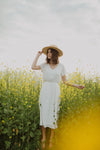 The Derby Dress in White, lifestyle shoot; front view
