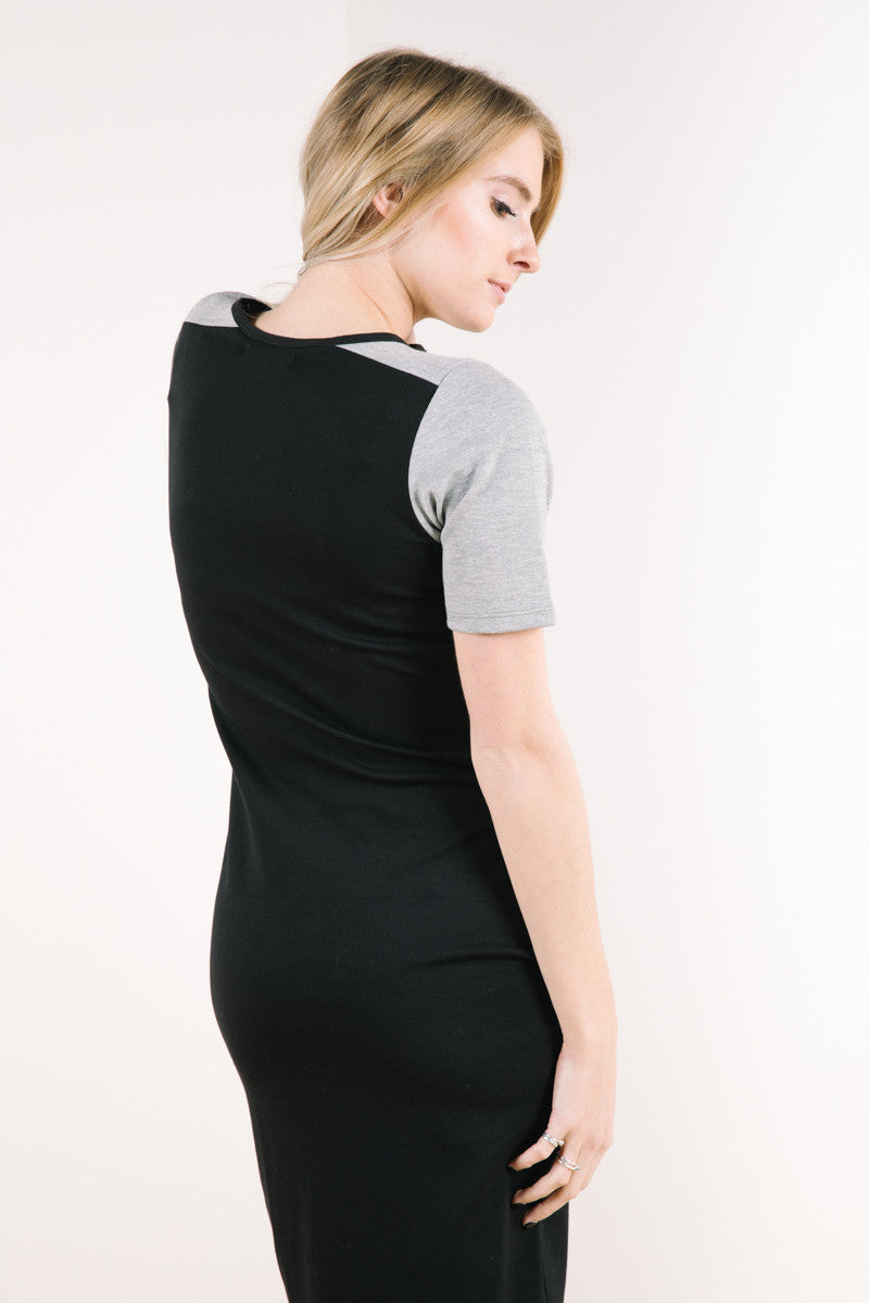 Back of model wearing tahoe dress in black