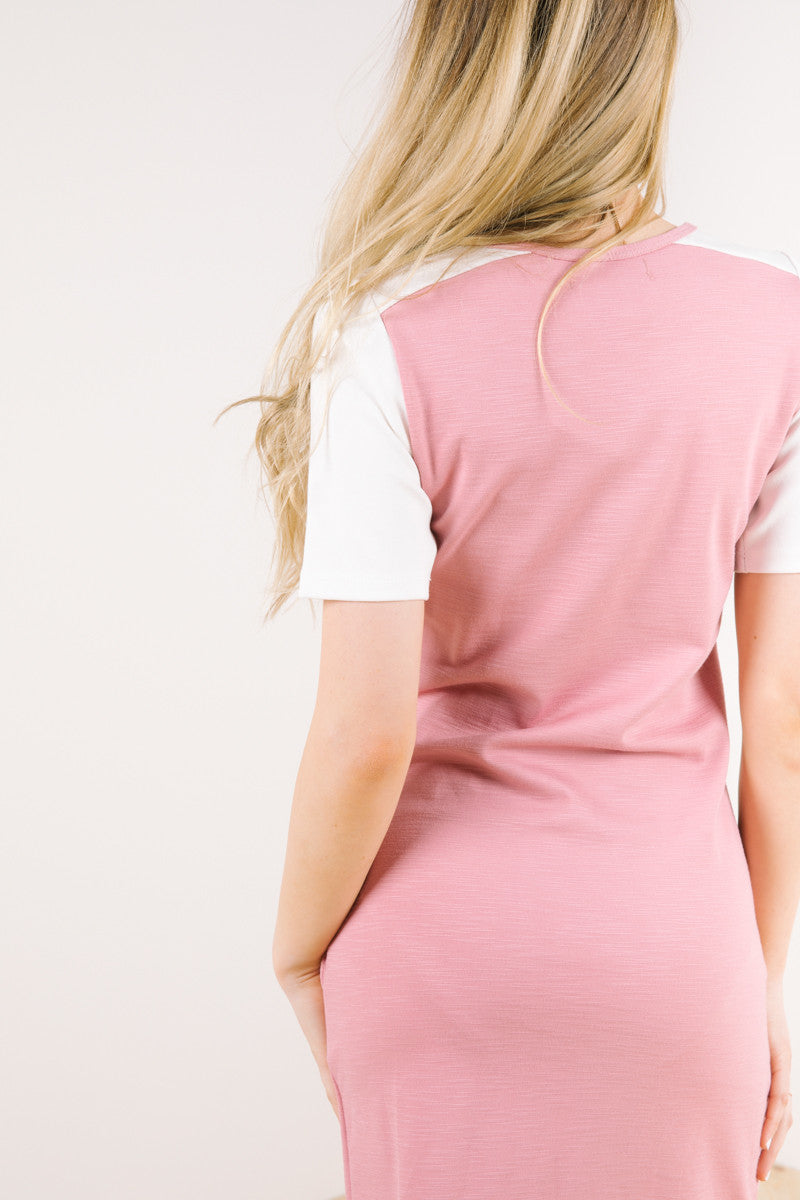 Back of model wearing tahoe dress in dusty rose