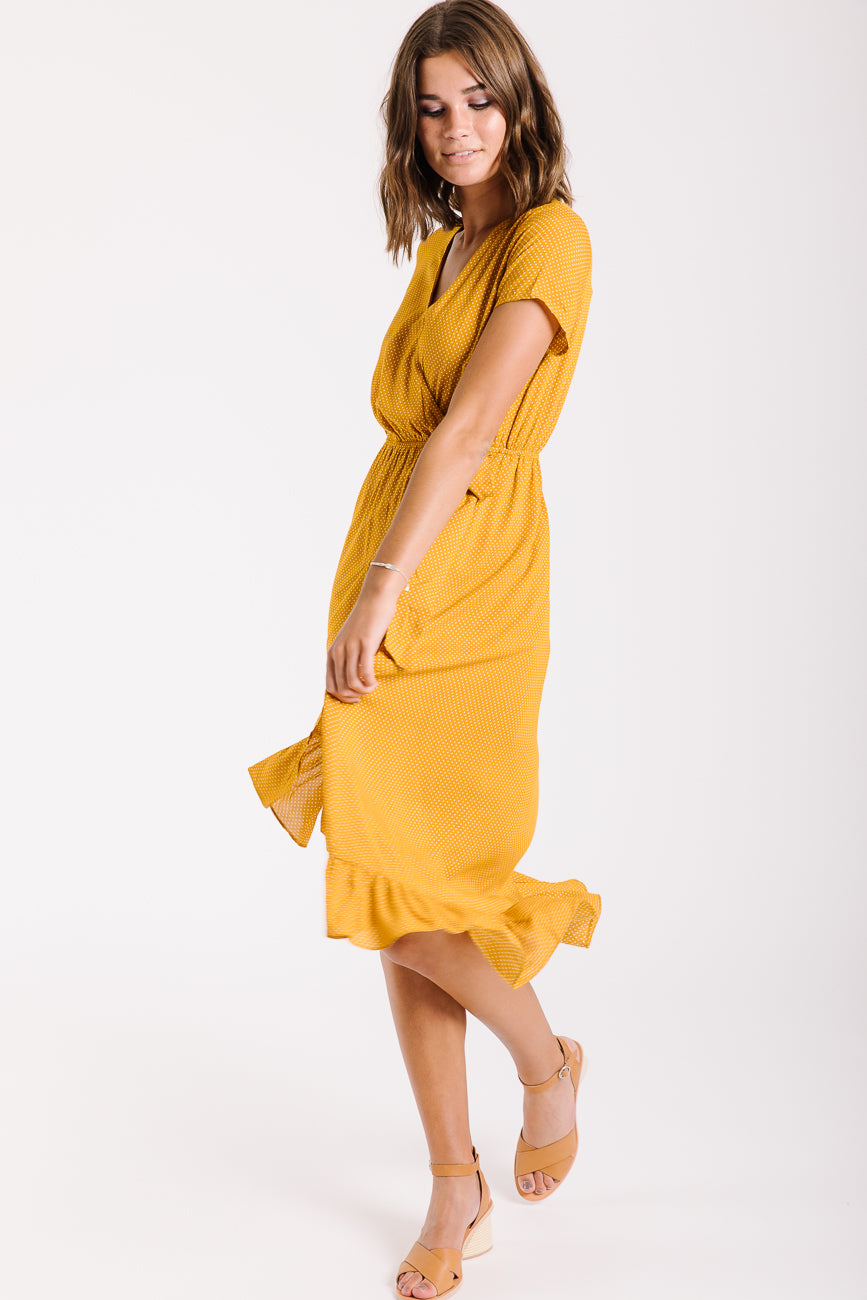 The Castleford Ruffle Wrap Dress in Mustard Mini Dot
