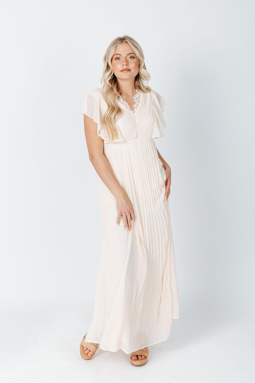 The Blaine Pleated Detail Dress in Cream, studio shoot; front view