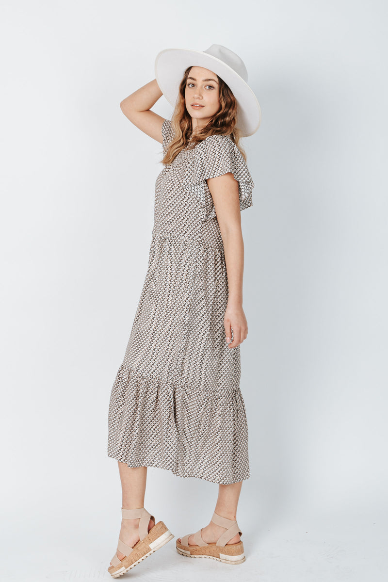 The Stanley Patterned Dress in Black, studio shoot'; side view