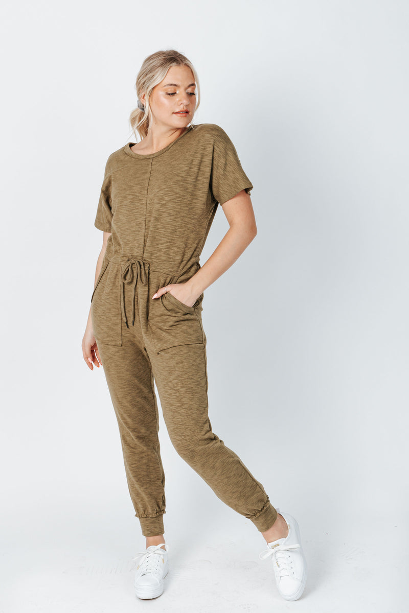 The Hugh Casual Jumpsuit in Olive, studio shoot; front view