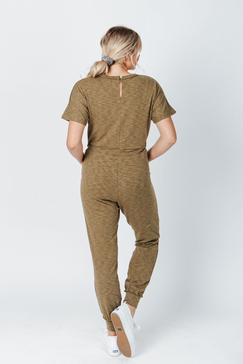 The Hugh Casual Jumpsuit in Olive, studio shoot; back view