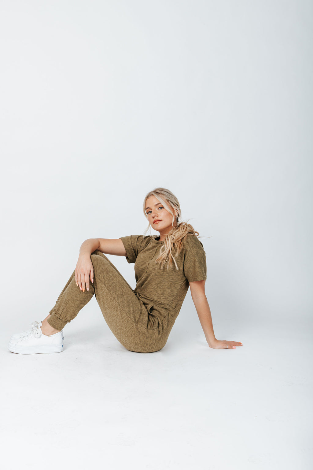 The Hugh Casual Jumpsuit in Olive, studio shoot; side view