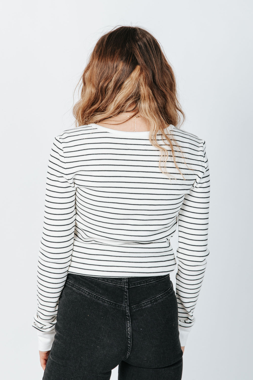 The Maeve Long Sleeve Tee in Black Stripe, studio shoot; back view
