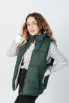 The Wyatt Reversible Vest in Hunter Green, studio shoot; side view